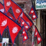 01 Street Vender Displays Nepalese National Flag on his stall at Basantapur in Kathmandu Nepal