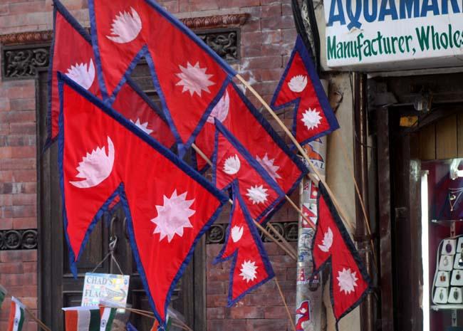01 Street Vender Displays Nepalese National Flag on his stall at Basantapur in Kathmandu Nepal