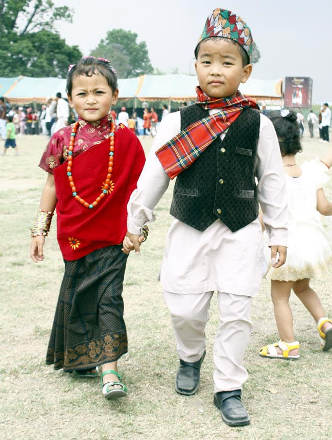 Child Wearing A Traditional Nepali Dress Observes The Gaijatra ...