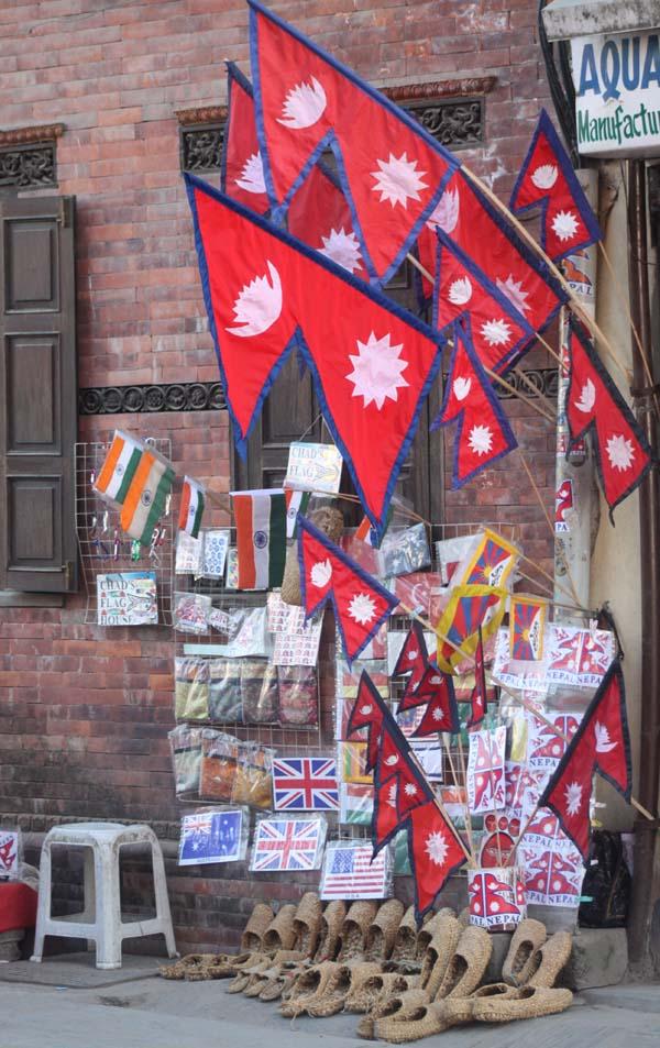 02 Street Vender Displays Nepalese National Flag on his stall at Basantapur in Kathmandu Nepal