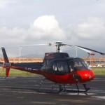 01 A helicopter parked on helipad of International Airport Kathmandu, Nepal