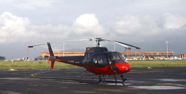 01 A helicopter parked on helipad of International Airport Kathmandu, Nepal