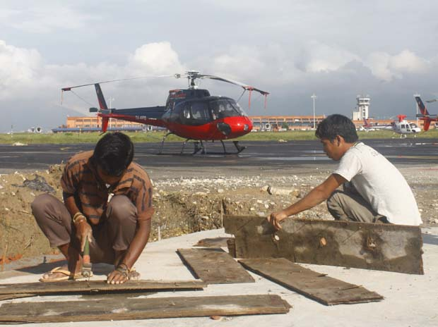 02 A helicopter parked on helipad of International Airport Kathmandu, Nepal