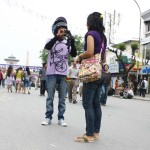 Taking Photo of Girlfriend on street using Mobile Phone in Kathmandu Nepal