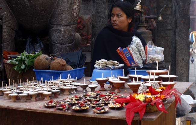02 Woman with worship accessories on her street stall in Basantapur