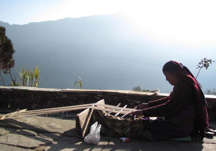 01 An elderly woman weaving clothes in Ghandruk, Nepal
