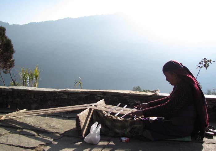 01 An elderly woman weaving clothes in Ghandruk, Nepal