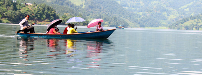 01 People passing through Begnas Taal (Begnas Lake) Pokhara Kaski Nepal