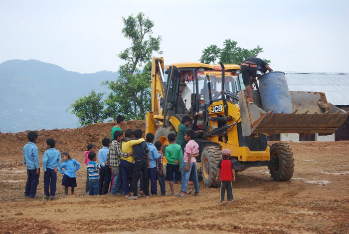 01 School children getting closer to know the Backhoe Loader in Palpa