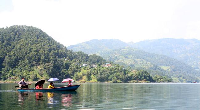 02People passing through Begnas Taal (Begnas Lake) Pokhara Kaski Nepal